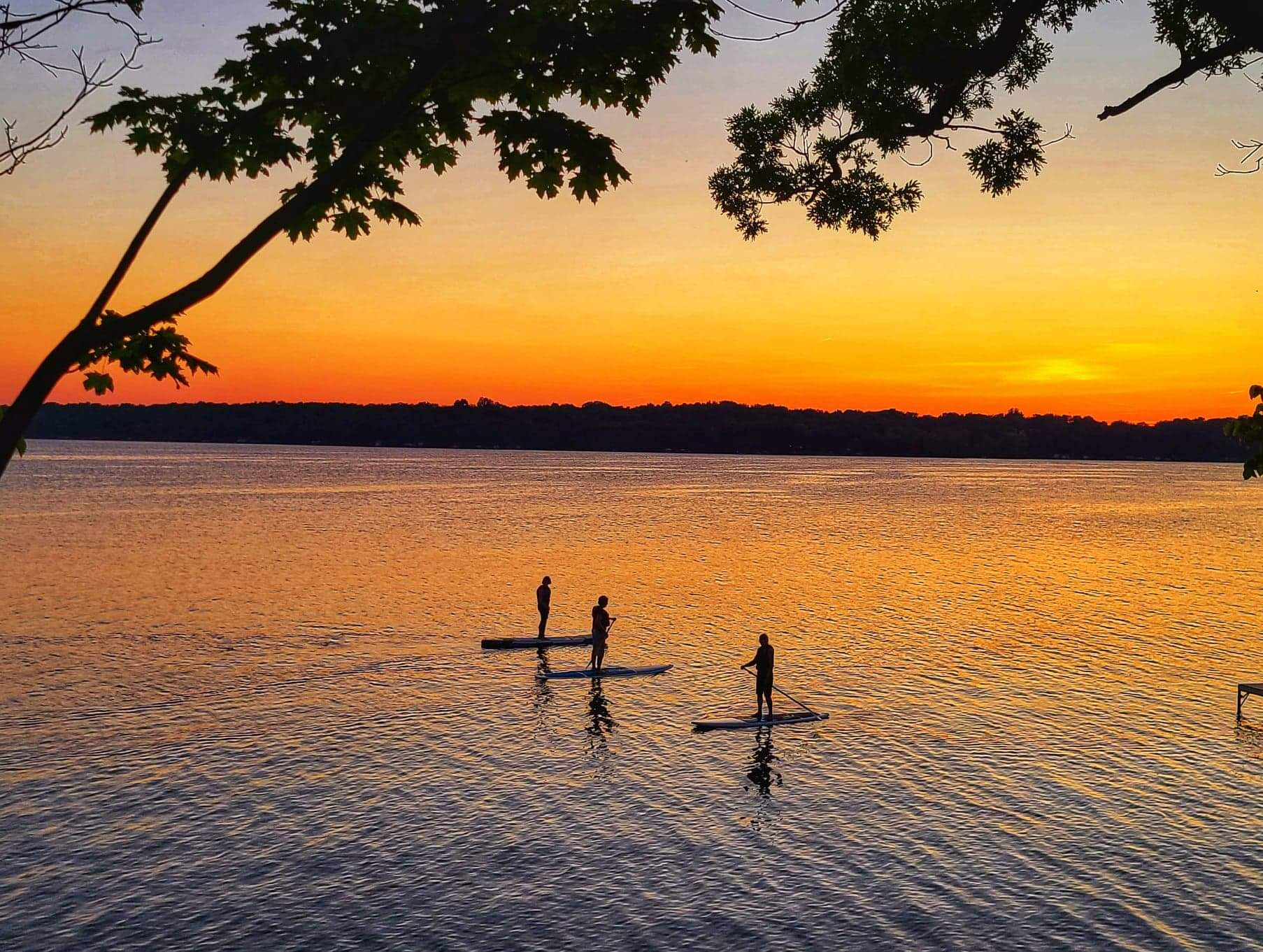 Paddle Boarders on Rock Lake, Lake Mills~photo by Sarah Grossman